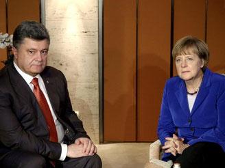 Bundeskanzlerin Merkel kommt in Mailand mit dem ukrainischen Präsidenten Poroschenko zusammen. Foto: Mykhailo Palinchak/TASS