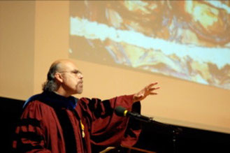 "Professor, David Carrasco lecturing on the Artwork of George Yepes, ""Re-Imagination of the Sacred"", at Harvard University."
