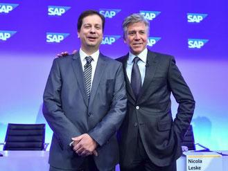 Der Softwarekonzer SAP verlängert die Verträge von McDermott (r) und Mucic. Foto: U. Anspach/Archiv