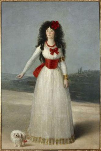 Mªdel Pilar Teresa Cayetana de Silva, XIII duquesa de Alba, obra clave del retrato aristocrático de Goya, quien consiguió su mecenazgo.Casada con José Alvarez de Toledo, luce como testimonio de ese amor un brazalete en su brazo izquierdo con dos letrasSyT