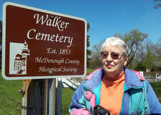 Marge Harris, cemetery trustee and historian, accepts a new sign for the Walker Cemetery donated by the McDonough County Historical Society and Clugston Tibbitts Funeral Home.