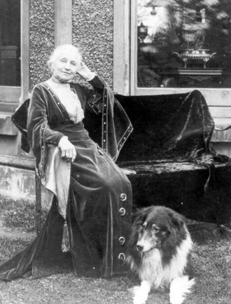 Mary Walker at the Hall with her dog Laddie, probably 1920s