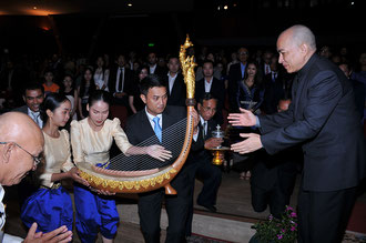 Donation of the Royal Harp by Sounds of Angkor to His Majesty Norodom Sihamoni, King of Cambodia, by Phloeun Prim, director of Cambodian Living Arts