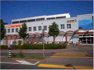 Coop-Center Bäckerei Post Bank Optiker Porzellanders