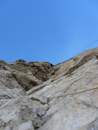 Chrissi leading the first roof pitch. Ropes and Slovakians ahead!