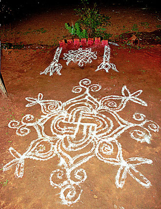 A young Neemtree and seven red coloured stones are forming a chtonic altar for the Godess Kanniyammal.