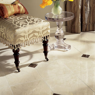 Crema Marfil cream marble floor tiles with dark brown Emperador Dark marble accents.
