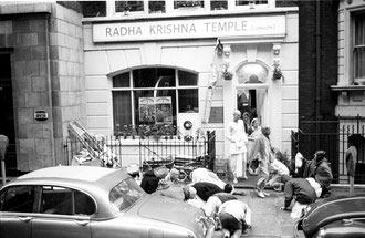 Srila Prabhupada greeted by disciples in original Hare Krishna temple in London (late 60`s)
