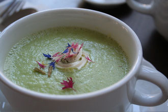 "Zucchini Soup with edible flowers and almond ""crème fraìche"""