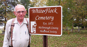 Richard Jackson admires the new sign at the White Flock Cemetery installed by the McDonough County Historical Society. Dick and his wife Marilyn cosponsored the new sign.