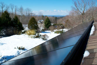 Distant Hill Gardens 3.15 kW roof mounted Photovoltaic Array using SunPower Signature™ black solar panels.