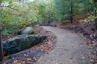 A section of accessible hiking trail at Crotchet Mountain Rehabilitation Center in Greenfield, New Hampshire. This incredible trail system was designed and built by Peter Jensen and Associates, LLC.