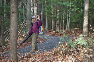 Michael Nerrie clearing leaves from the Distant Hill Nature Trail.