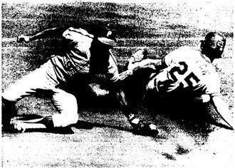 Manny Trillo cannot field an errant throw from Bob Boone.