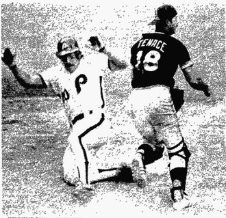 Mike Schmidt slides home safely to score the winning run.