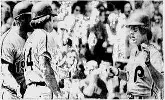 Mike Schmidt is greeted at home by Pete Rose and Greg Luzinski following his 40th homer in the first inning.