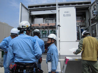 OF employees are inspecting the power conditioner to test out the succes and conversion effeciency of the solar panels.
