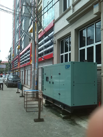 Generator - Tank Kombination in Yangon, Myanmar zur Absicherung der Stromversorgung bei Netzausfall. / Generator with fuel tank to cover grid outages for an ofice building in Yangon, Myanmar.