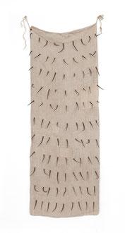 Christa Schmid - Ehrlinger , o. T., 1998; alter Mehlsack, handgeschmiedete Nägel,  156 x 57 cm / untitled, 1998, flour bag, hand-forged nails, 61.5 x 22.5 inches