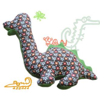 Grüner Dino aus Sweatshirtstoff