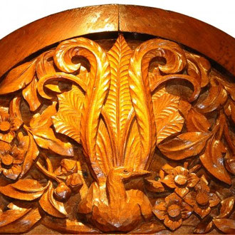 (DR) John Grant's carving of a lyrebird and clematis. It is one of 16 panels in the school hall at Villers-Bretonneux. Photo: Courtesy Amanda Wescombe