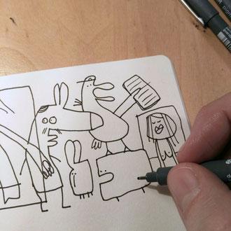 erste Figuren des Motives Depression zeichnen mit Tusche auf Papier als comicartige Kreaturen