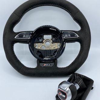 Volant Audi RS4 Amantea noir, épaississement de la jante en IV3 Aéro, point de croix, fil gris, gainage pommeau et soufflet assorti