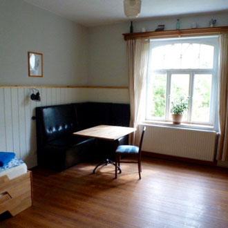 Ein Schlafzimmer im Landhaus Lenzener Elbtalaue
