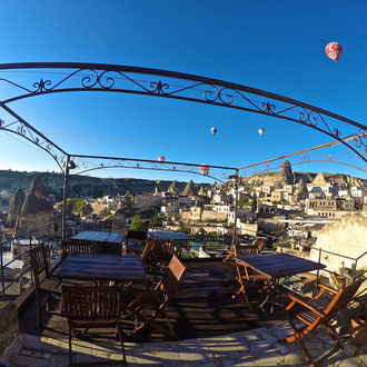 Watch the hot air balloons from the balcony