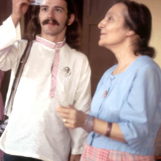 1975 Meherazad : Mehera with Anthony Zois are admiring Meher Baba's hair that she gave him as a love gift. Photo taken by Sher DiMaggio Zois
