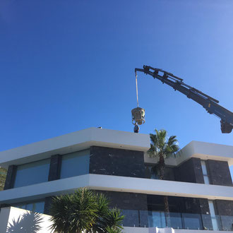 A crane lifting the construction materials and new airconditioning machine up