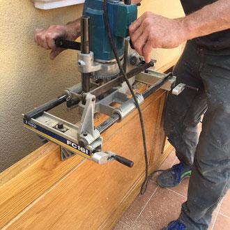 Carpenter fitting a new lock