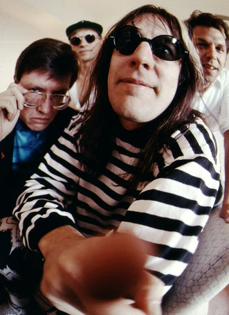 Rocker Todd Rundgren and his band investigate the front end of the camera...