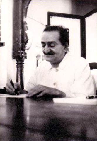 "Meher Baba signing copies of the frontal pages of ""God Speaks"" book."