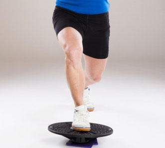 Balance lunge stability exercise on wobble board