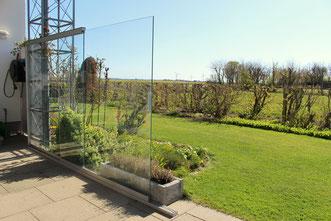 Terrassenverglasung als Windschutz