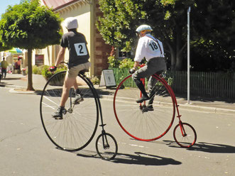 Two penny-farthing cyclists