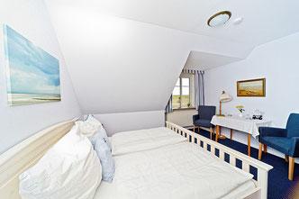 Bett im Doppelzimmer Gröde