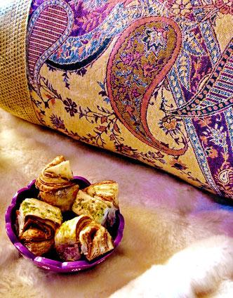 View of rich paisley pattern on pashmina cushion