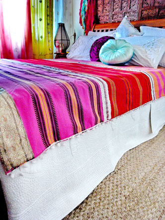 Three-piece, pink, orange and red striped, flat weave, Indian cotton throw with gold/peach jari border and white pom-pom trim