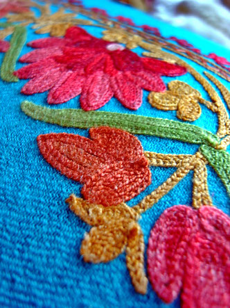 Detail of woolen floral embroidery on pashmina wool cushion cover