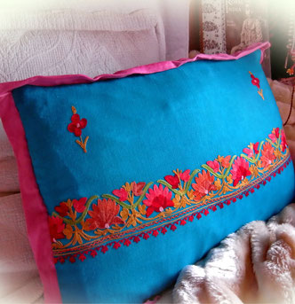 Deep, topaz-blue, pashmina-shawl chusion cover, with bright, floral embroidery & berry-pink, super-soft, pashmina edging
