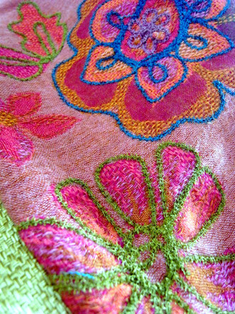 Detail of thick, colourful woollen embroidery