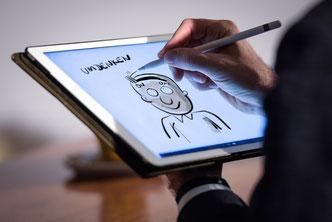 Stefan Wirkus zeichnet auf dem iPad die Inhalte Ihrer Tagung mit
