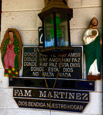 "Example of a saint plaque, the bottom says ""God bless our home""."