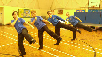 Kung Fu students performing a roundhouse kick