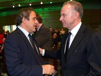 ECA-Chef Karl-Heinz Rummenigge (r) fand eine Einigung mit UEFA-Präsident Michel Platini. Foto: DFB/Getty Images/Lars Baron
