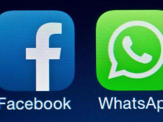 Die beiden Logos von Facebook und WhatsApp. Foto: Patrick Pleul/Illustration