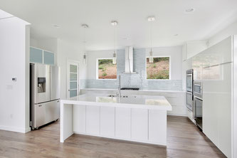 Modern Kitchen with marble benchtop renovated by Sydney Budget Kitchens
