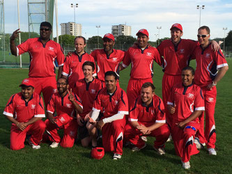 The victorius WCC XI looking splendid in their red coloured kit